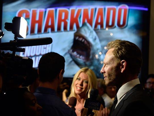 Actors Tara Reid and Ian Ziering at a 2013 event for