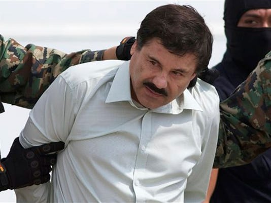 """FILE - In this Feb. 22, 2014, file photo, Joaquin """"El Chapo"""" Guzman, head of Mexico's Sinaloa Cartel, is escorted to a helicopter in Mexico City, following his capture overnight in the beach resort town of Mazatlan. Mexico's security commission said in a statement late Saturday, July 11, 2015, the top drug lord Joaquin  El Chapo' Guzman has escaped from a maximum security prison, the second time he has fled after being captured."""