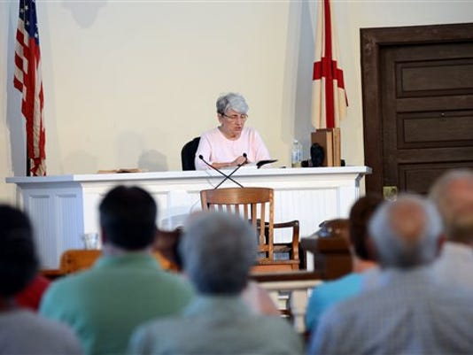 """Nancy Rogers reads """"Go Set A Watchman"""" in the old Monroe County Courthouse on the morning of the book's release in the hometown of """"To Kill a Mockingbird"""" author Harper Lee, in Monroeville, Ala., Tuesday, July 14, 2015."""