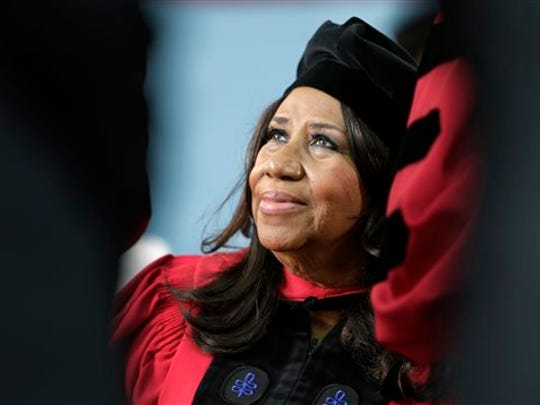 FILE - In a Thursday, May 29, 2014 file photo, singer Aretha Franklin looks up while seated on stage during Harvard University commencement ceremonies, in Cambridge, Mass. Franklin, the Queen of Soul says she's looking forward to tracking down one of the powdered sugar-covered confections while she's at the Ohio State Fair to perform on Thursday, July 31, 2014.