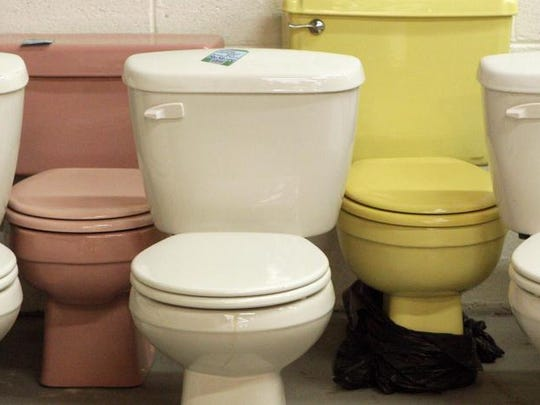 In this file photo, multicolored collection of commodes is on display at ReStore, the Prices Corner furnishings, houseware and construction supply outlet run by Habitat for Humanity.