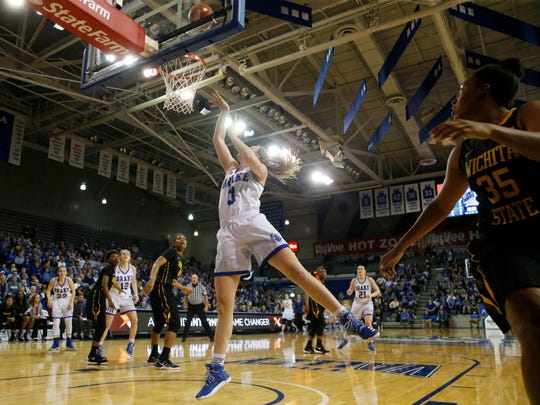 Drake forward Lizzy Wendell (3) gets the layup over Wichita State Saturday, March 4, 2017 at the Knapp Center in Des Moines.