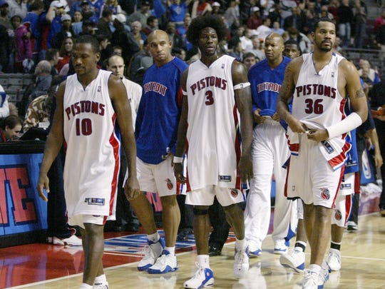 Detroit Pistons players, from left, Lindsey Hunter (10), Darvin Ham, Ben Wallace (3), Derrick Coleman and Rasheed Wallace (36) head to the locker room after their game against the Indiana Pacers was called after a fight Friday, Nov. 19, 2004, in Auburn Hills, Mich. (AP Photo/Duane Burleson)