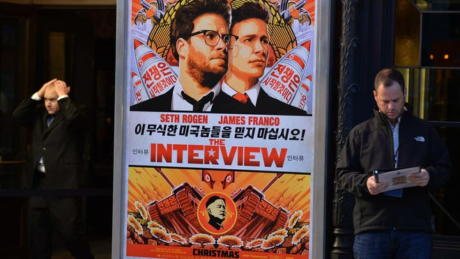 "Was8890533.jpg (FILES) In this December 11, 2014 file photo, security is seen outside The Theatre at Ace Hotel before the premiere of the film ""The Interview"" in Los Angeles, California. CNN on December 23, 2014 reported that two independent movie theaters, the Plaza in Atlanta, Georgia and the Alamo in Austin, Texas will show ""The Interview"" on Christmas day December 25. The film starring US actors Seth Rogen and James Franco, is a comedy about a CIA plot to assassinate its leader Kim Jong-Un, played by Randall Park. AFP PHOTO/STR/FILESSTR/AFP/Getty Images"