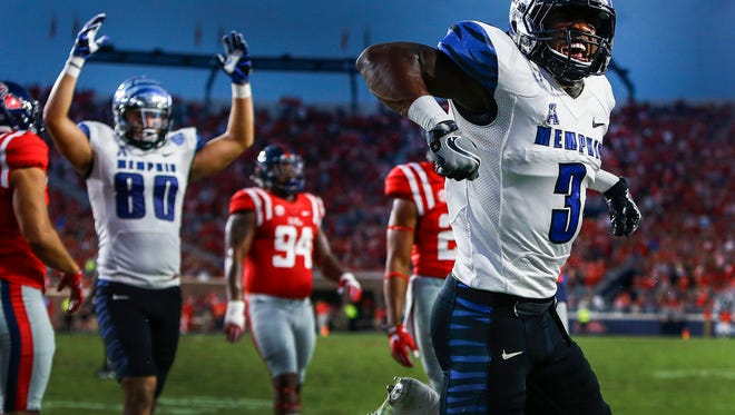 October 1, 2016 - University of Memphis receiver Anthony Miller (right) celebrates a 7 yard touchdown run against the against Ole Miss defense during second quarter action at VaughtÐHemingway Stadium in Oxford, Miss.   (Mark Weber/The Commercial Appeal)