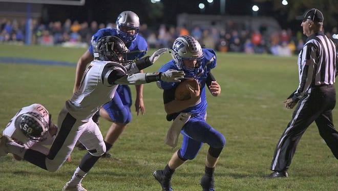 Zach Hoffman sheds a tackle against Gibsonburg in the regional quarterfinal.