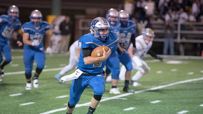 Zach Hoffman runs the ball against Ayersville in the regional semifinal. Hoffman finished the season with just shy of 3,500 total yards of offense.