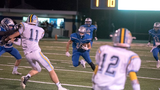 Zack Houck rushes the ball against Ayersville last week in the regional semifinal. Houck will be an important cog next season in the Royals' running game.