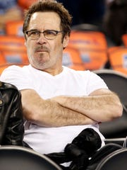 Dennis Miller gets ready to watch a Final Four game April 7, 2014, at AT&T Stadium in Arlington, Texas.
