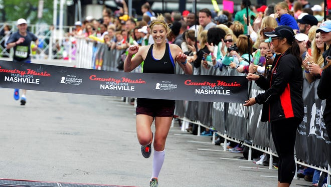 Melanie Kulesz wins the women's race at the St. Jude Country Music City Marathon on Saturday April 25, 2015, in Nashville.