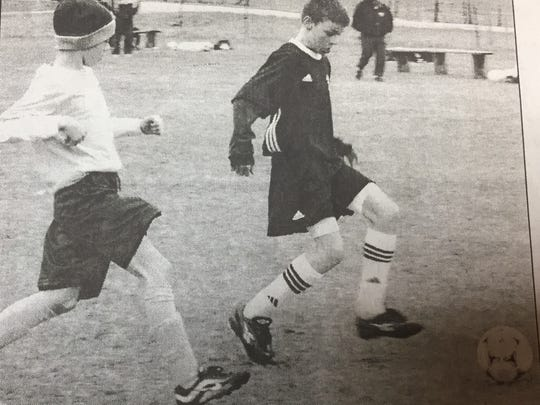 Morgan Meighan goes for a goal at the start of the Union County YMCA spring soccer season in March 2002.