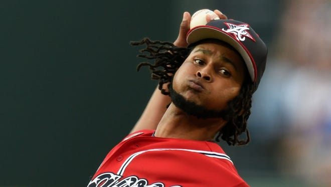 Atlanta Braves starting pitcher Ervin Santana pitches against the Arizona Diamondbacks during the first inning at Turner Field.