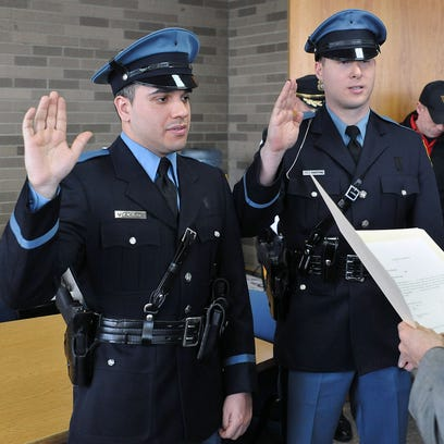 Vineland police officers Owen Flores (left) and Brian