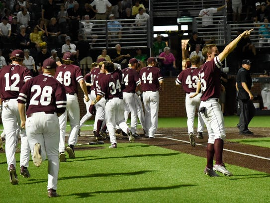 Mississippi State celebrates a run in the bottom of