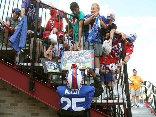 Bills running back LeSean McCoy signs autographs as
