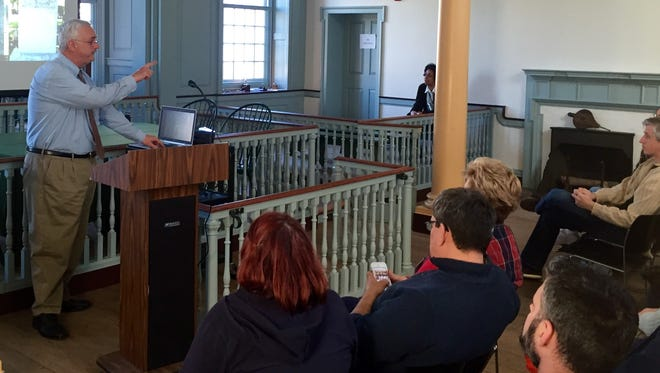 Michael Dixon, a local historian, leads a discussion about the history of cemeteries, burials and tombstones at the Old State House in Dover on Saturday January 2, 2016.