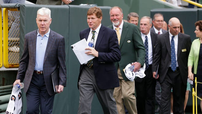 Green Bay Packers general manager Ted Thompson, left, and President and CEO Mark Murphy enter Lambeau Field on Thursday for the annual shareholders meeting.