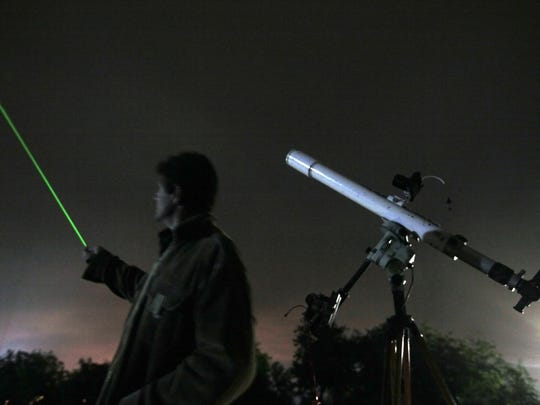 An astronomer uses a laser pointer to show the radiant of the Orionids meteor shower at an observatory in Bulgaria. Such lasers, which are widely available and are much more powerful than office pointers, are being shined by pranksters at aircraft in flight.  Petar Petrov/AP An astronomer uses a laser pointer to show the radiant of the Orionids at an observatory near the village of Avren east of the Bulgarian capital Sofia, Tuesday, Oct. 20, 2009. The Orionid meteor shower occurs each year as a result of Earth passing through cosmic dust released by Halley's Comet. The radiant of the Orionids is located near the constellation Orion. (AP Photo/Petar Petrov)