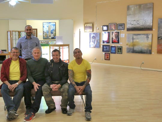 Valerio Iovion, standing, of the Desert AIDS Project, coordinated an art show of client work.  Those clients pictured are, from left, Bruce Tunis, John Luckett, Sean Ivory and Nicholas White