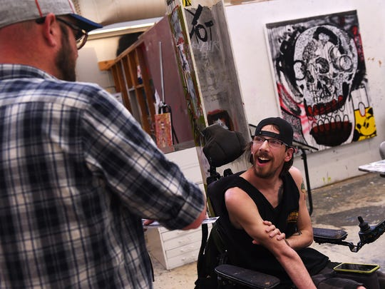 Connor Fogal, right, interacts with his teacher Ahren Hertel during his Intro to Painting class at the University of Nevada, Reno on April 21, 2016.
