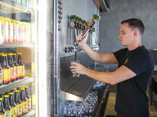 Craig Elsken of the La Quinta Brewing Company pours a beer at their new Palm Springs tap room, June 19, 2018.