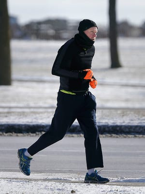 There were just a few runners along Lincoln Memorial Drive as bitter-cold temperatures spread across southeast Wisconsin.