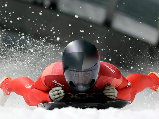 Janine Flock of Austria finishes her first run during the women's skeleton competition at the 2018 Winter Olympics in Pyeongchang, South Korea, Friday, Feb. 16, 2018. (AP Photo/Wong Maye-E)