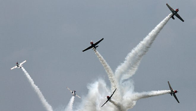 The Geico Skytypers leave a trail of smoke as they perform for the crowd during the New York Air Show at Stewart Airport in Newburgh Sunday