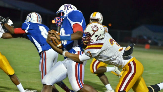 Perry Central's McKail Sumrall brings down a North Forrest ball carrier Friday at Eatonville.