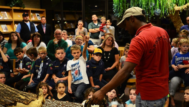 Marysville Public Library hosted an exotic animals night. Jaron Stacks, Exotic Zoo owner, teaches about Molly, a two-year-old ball python.