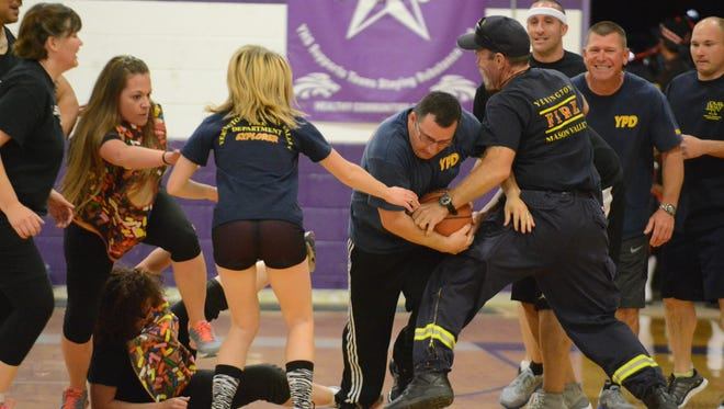 This scrum turned into a bit of a rugby scene in the final moments of the law enforcement versus firefighters basketball game to conclude last Saturday's Hoop's for Heroes fundraiser.