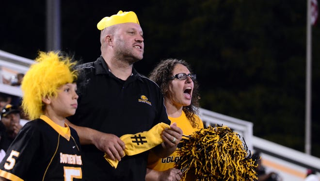 Brandi Soule, right, cheers during the Southern Miss football game against Marshall on Saturday at M.M. Roberts Stadium.