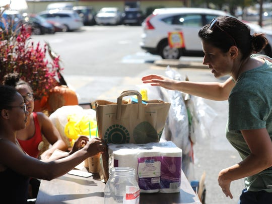 Carrie Black, right, donates a variety of goods at