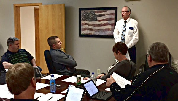 Financial consultant Norman Hill of Norman Hill Enterprises outlines his fiscal distress correction plan for the Yellville-Summit School Board.