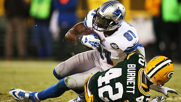 Calvin Johnson makes a catch during the Lions' 30-20 loss last season in Green Bay.