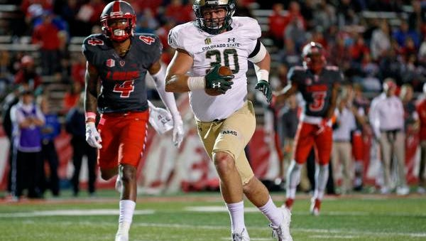 Colorado State tight end Dalton Fackrell (30) scores a touchdown past New Mexico safety Bijon Parker (4) during the first half of an NCAA college football game in Albuquerque, N.M., Friday, Oct. 20, 2017.