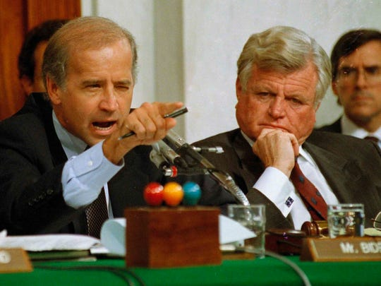 In this Oct. 12, 1991 file photo, then Senate Judiciary Committee Chairman Sen.  Joe Biden, D-Del., points angrily at Clarence Thomas during comments at the end of hearings on Thomas' nomination to the Supreme Court on Capitol Hill. Sen. Edward Kennedy, D-Mass. looks on at right.