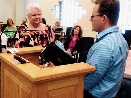 """Patricia Hamilton of the Grant County CYFD Youth and Family Services Division, left, listens as Mayor Michael Morones reads a proclamation declaring April """"Child Abuse Prevention Month"""" in Silver City on Tuesday during the Town Council meeting. Randal Seyler - Sun-News"""
