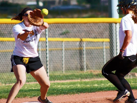 Sierra Gentry catches a ball at third base during practice at the Grady Fields Wednesday afternoon as Courtney Grubbs runs towards third.