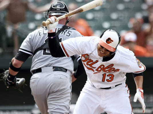 Baltimore's Manny Machado slams his bat after striking out against the Chicago White Sox in the eighth inning of the first game of a baseball doubleheader on Thursday in Baltimore. The White Sox won 3-2. Machado was ejected on the play.