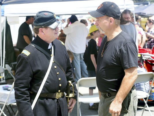 Jeffrey Furry, left, of Chambersburg represents the 83rd Pa. Union regiment as he talks with Don Freeman of Walkersville. Md. on Friday during ChambersFest's Old Market Day in Chambersburg.