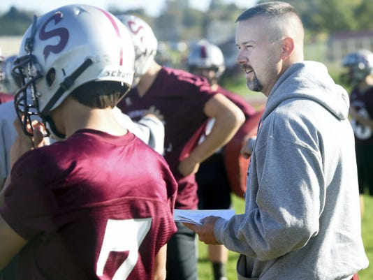 Shippensburg's offensive coordinator Kevin Gustafson calls in plays to his team during a practice earlier this season.