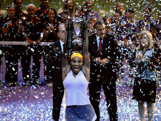 Serena Williams of the USA raises her trophy after defeating Li Na 2-6, 6-3, 6-0 in the final of the WTA Championships.