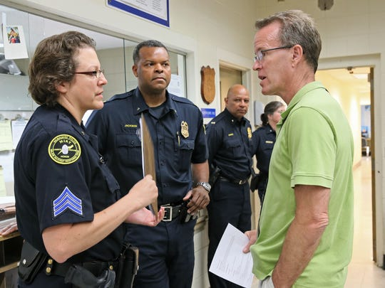 A roll call is held in 2015 at Milwaukee police District 7 station, where officers were briefed on a new program being tested in the district. Under the program mental health professionals would try to intervene with victims and witnesses of traumatic situations.