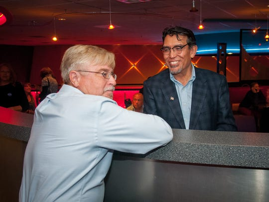 Richard Hall, left, a candidate for the District 4 council seat, talks with mayoral candidate Miguel Silva at an election night watch party Tuesday at the Launchpad Cafe. Neither Hall nor Silva, who were each supported by GOAL WestPAC, won their respective race.