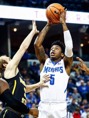 Memphis guard Kareem Brewton Jr. (right) puts up a shot against Wichita State defender  Conner Frankamp (left)  during first half action at the FedExForum in Memphis Tenn., Tuesday, February 6, 2018.