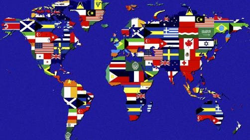 World map covered with flags of different nations