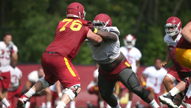 Iowa State junior defensive tackle Demond Tucker, right, pushes senior offensive lineman Jamison Lalk during an open practice on Friday, Aug. 7, 2015, at the Iowa State practice facility near Jack Trice Stadium in Ames, Iowa.