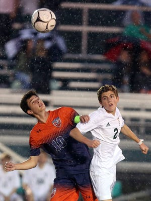 William Seidman of Horace Greeley and Joey Carbone of Yorktown battle for the ball during a varsity soccer game at Yorktown High School Oct. 11, 2017. Yorktown defeated Greeley 1-0.