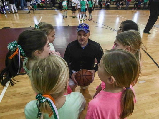 Chris Lord provides instructions to players from the Irish Unicorns (left) and The Basketball Fighters (right) in the 3-versus-3 charity basketball tournament Saturday, March 5, in Wilmington.